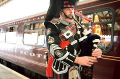 Piper greets the Royal Scotsman train as it meets the Hebridean Princess