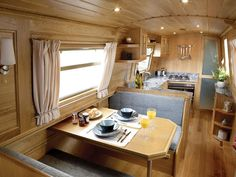 An Aqualine Monaco with U shaped galley and a Pullman dinette which seats 4 but also converts to a double bed for guests.