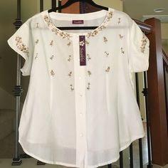 White Button Up Top. White shirt sleeve button up top with flower embroidered. % 100 cotton made in India. Saakhi Tops Button Down Shirts