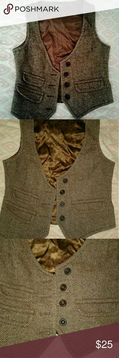 Vintage Benetton Herringbone Vest Brown tweed Herringbone vest from Benetton with satin lining and back with adjustable buckle. This is one of my favorite pieces but I just don't wear it. There is a small tear in the lining by the tag I noticed when inspecting it for sale. United Colors Of Benetton Jackets & Coats Vests