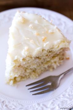 This triple layer cake is filled with delicious coconut flavor and topped with a to-die for cream cheese frosting! Easy and so, so delicious! | www.alattefood.com