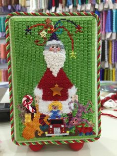 Love this background. Found the stitch here: http://www.needlepoint.org/StitchOfTheMonth/2004/feb.php. Looks like couching