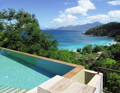 A pool with a view at Four Seasons Resort Seychelles