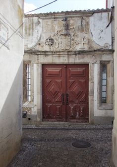 A surprising portal greets you on a street in Santarém.
