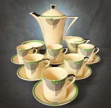 Typical deco, love! Doulton Deco: Tango earthenware coffee set, black/green/green, rare.