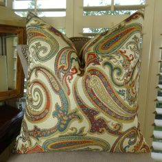 Paisley Cove     Beautifully crafted. The front fabric of this upscale accent #pillow is polyester in cream and red colors. At $ 66.00.