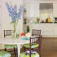 Adding bright, patterned seat cushions to this otherwise neutral room gives this kitchen just the pop of color is needs!