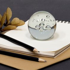 """""""A decorative paperweight can help you bring order to your paperwork,"""" Clara insists. In shops now. Glass paperweight, price DKK 23,90 / SEK 32,90 / NOK 33,90 / EUR 3,38 / ISK 638 / GBP 3,19"""