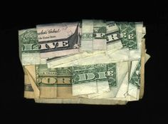 """A folded money print spelling """"Life Free or Die"""" by New Orleans artist Dan Tague"""