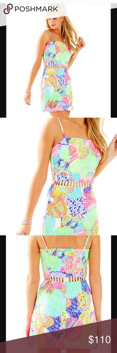 NWT Lilly Pulitzer Ziggy Romper Dress Sz M Peek-a-boo! The Lilly Pulitzer Ziggy Romper in Multi Roar of the Seas has a gold cutout detail at the waist makes it the ultimate party romper. It is a fitted romper with adjustable spagheti straps so you know it will look amazing on.  Strappy Romper With Gold Detail At Waist. Vintage Dobby-Printed (100% Cotton). Machine Wash Cold, Delicate Cycle. Absolutely adorable for those summer days. Size M. Brand new with tags. Lilly Pulitzer Dresses Mini