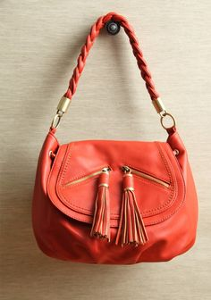 """Molly Braided Convertible Shoulder Bag By Melie Bianco 89.99 at shopruche.com. Designed in vibrant red leatherette, this bag by Melie Bianco features gold colored hardware, optional shoulder strap, and a drawstring closure., ,  All man-made materials,  15""""L x 7""""W x 9""""H ,  10"""" strap drop,  Draw string and flap closure ,  2outer pockets,  Roomy interior compartment includes smal..."""