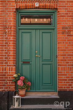 green door red brick exterior