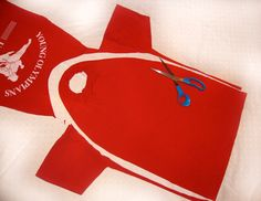 when i made these TSHIRT CAPES i cut along the shoulder seams and thru the collar band. i strung ribbon thru the neck band and put the velcro on the ribbon. i got 2 shirts per T! the kids love love love 'em!