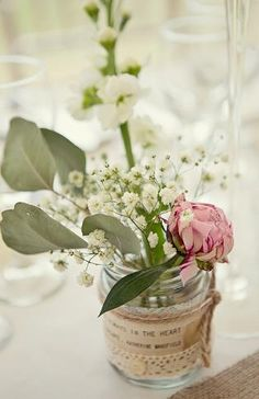 Note on individual flower arrangement favors.