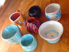 Ceramic milk jugs and small bowls