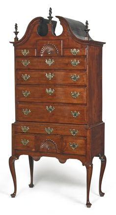 THE LEARNED FAMILY QUEEN ANNE CARVED WALNUT BONNET-TOP HIGH CHEST OF DRAWERS, ESSEX COUNTY, MASSACHUSETTS, CIRCA 1766 -  Appears to retain its original cast-brass hardware and finials, with one flame replaced.  Inscribed on reverse in chalk By the will of God – W.D. May 11, 1766. Height 85 3/4 in. by Width 41 in. by Depth 21 1/2 in.