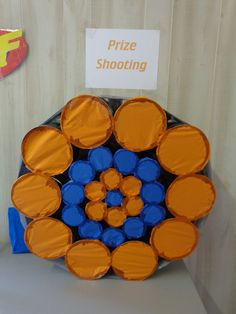 Nerf Prize Shooting....I made this from various sized cans that I glued & duct taped together. I filled them with prizes & glued a thin piece of tissue paper to each one. Each child got to shoot at the target and they got the prize from the can that they hit.