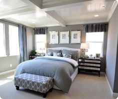 My husband would love this, hes currently obessed that the living room of our next house will be grey.  Here is a master bedroom in shades of gray and white