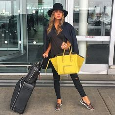An all-black outfit works anywhere, anytime. Top if off with a smart-looking black fedora and a bright bag.