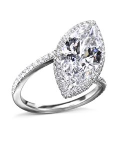 Exquisite Marquise-Cut Diamond Ring made in platinum with a marquise-cut diamond center and 146 pavé-set diamonds in th ehalo and band. Marquise Cut Diamond Ring, Diamond Cuts, Wedding Ring Designs, Wedding Rings, Unique Diamond Engagement Rings, White Gold, Timeless Beauty, Diamonds, Halo