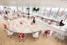 teamlab's digital office for DMM in tokyo features a 1-kilometer-long desk