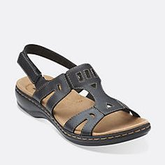 Easy summer style that doesn't sacrifice comfort. This sandal from the Clarks Collection features stretch goring for a custom fit, textile linings, a CushionSoft with OrthoLite® footbed, and a lightweight EVA outsole. With its walkable low heel, this women's sandal is perfect to slip on for any casual occasion.