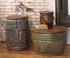 Vintage Grain Barrel CoffeeTables      These timeless treasures were used for decades for storing grain, and their rich color and patina can attest to their lifetime of service. Using character-rich teak tops, artisans craft them into versatile storage tables. The coffee table is great for blankets and serving pieces; the occasional table hides games and books. The hinged tops offer easy access