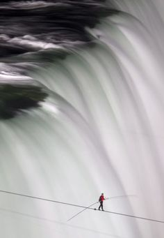 Nik Wallenda walks over Niagara Falls on a tightrope. As he crossed, Wallenda said he had an 'unbelievable view' from the cable.