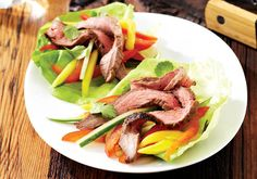 Flank Steak Lettuce Wraps - Oxygen Women's Fitness.  A great way to lose the bun and still have a 'sandwich' or 'taco'.  I don't believe in going carb free, but if you're having a meal later in the day, this is a good 'wrap' replacement.