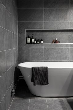 Keep it clean and simple with large-format gray tiles and a gorgeous ...