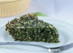 No Crust Greek Spinach & Feta Pie 2 packages (20 oz) frozen chopped spinach, thawed 1 1/2 cup feta cheese, light 3/4 cup green onions, chopped 1 cup dill, chopped 3/4 cup parsley, chopped 1/4 cup egg whites 1 egg 1 cup skim milk 1/2 cup whole wheat flour 3 cloves garlic, crushed 1/2 tsp baking powder Pinch of salt Ground black pepper to taste
