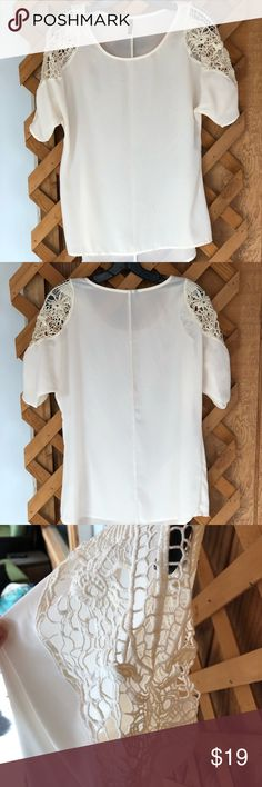 CUTE WHITE SHIRT WITH CROCHET SHOULDERS This shirt is extremely cute especially with the crochet shoulders and perfect for the warm weather and has barley been worn! Tops Blouses