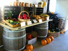 great way to set up farm stand, old door and wine barrels