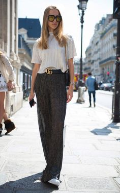 Take away her bumper shades and logo belt, and this show-goer's outfit would not turn heads. Proof that when it comes to standout looks, it's the little tweaks that make all the difference