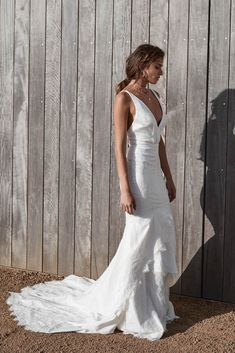 June wedding dress | One Day Bridal | CHOSEN – New Reign Collection 2018 | Based off our best selling Kingston bridal gown, June is all about celebrating those curve. A fitted bodice with plunging neckline and low back perfectly balance the tiered lace fishtail skirt.