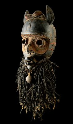 Africa | 'Deangle' mask from the Dan people | Wood, pigment, raffia, textile and metal