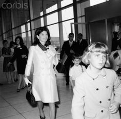 Jackie at JFK airport with niece Sydney Lawford, heading for Hawaii in 1966.