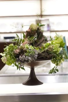 Woodland arrangement by Francois Weeks- I like the use of the elevated dish.