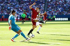 Gianluigi Buffon #1 of Roma clears the ball past Edin Dzeko #9 during the International Champions Cup 2017 match at Gillette Stadium on July 30, 2017 in Foxboro, Massachusetts.