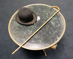 one of Charlie Chaplin's bowler hats and canes