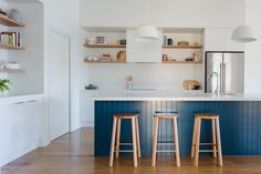 Kitchen design with white cabinetry, timber floating shelves, feature blue island bench and white subway tiles. Love the open shelves here, you can really change them up with styling and change the look of the kitchen. Timber Kitchen, Kitchen Benches, Kitchen Tiles, Kitchen Layout, Kitchen Design, Timber Floating Shelves, Timber Shelves, Blue Shelves, Open Shelves