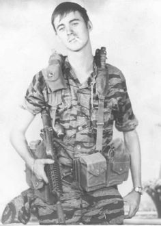 """Vietnam War - U.S. Army Special Forces soldier wearing the distinctive """"Tiger Stripe"""" jungle fatigues."""