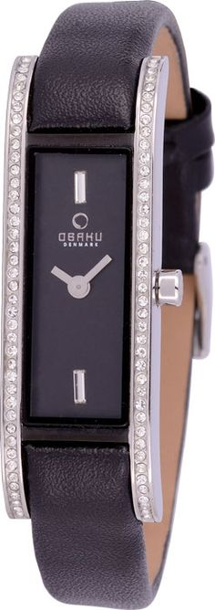 Stainless Steel casing surrounded by crystal, placed on a black leather bracelet. Water resistant to 3 atm. Price: $209.00