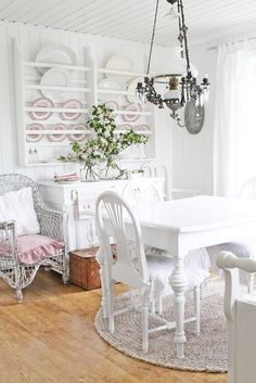 White Dining Room - beautiful white dining room, with a natural wood floor and pink accents - via VIBEKE DESIGN: Tribute to the most beautiful spring!