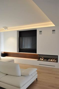 El salón: Salones de estilo moderno de Rardo - Architects Living Room Tv, Living Room With Fireplace, Home And Living, Küchen Design, House Design, Modern Tv Room, Indoor Jacuzzi, Sophisticated Living Rooms, New Staircase