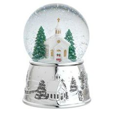 A quaintly designed church takes center stage in Reed and Barton's silver snow globe.