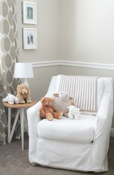 Beige & white patterned nursery.  Love the old pics on the wall- want to have pics of the family as babies/kids on the wall