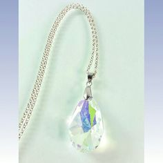 Large AB Crystal Teardrop Pendant Necklace Large Aurora Borialis Crystal Teardrop Pendant Necklace | Faceted 38 mm Chandelier Glass Crystal Prism | Sterling 925 Silver Plated Rolo Chain | Simple Solitaire Drop Necklace   Sterling Silver 925 Plated 18 inch Rolo Chain   Simple Elegant Modern Design  Wear Alone or Perfect for Layering  Dress It Up or Dress It Down, Day or Night, You Can't Go Wrong Rhinestones & Razorblades  Jewelry Necklaces