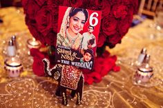 Oh how cute. Personalized table number with old school Bollywood posters featuring the bride  groom!!!!!