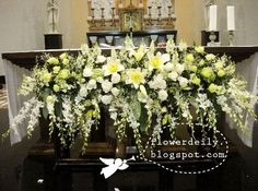Glorious flower arrangements in front of the main altar, using the popular white theme. Altar Flowers, Church Flowers, Funeral Flowers, Easter Flower Arrangements, Funeral Flower Arrangements, Ikebana, Church Altar Decorations, Wedding Reception Flowers, Wedding Venues